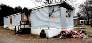 This mobile home at Ames trailer park in Skowhegan, seen Monday, was destroyed by a fire on Sunday, and the resident, Michelle Sweet, 53, was severely injured.