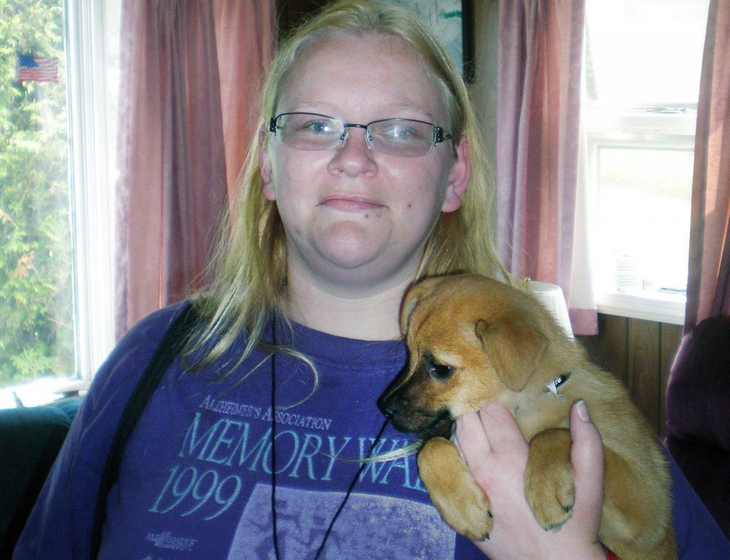 Michele Breault with her dog Lucky when we was a puppy.