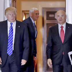 Andy Puzder, right, chief executive of CKE Restaurants, is reported to  be Trump's nominee for secretary of labor. Associated Press/Carolyn Kaster