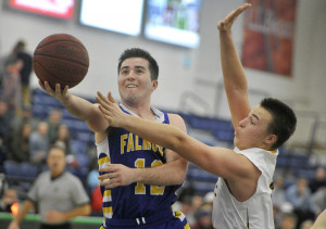 Falmouth's Collin Coyne drives to the basket past Cape's Marshall Peterson.
