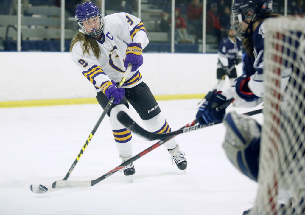 Lilly Wolff of Cheverus takes a shot in the second period.