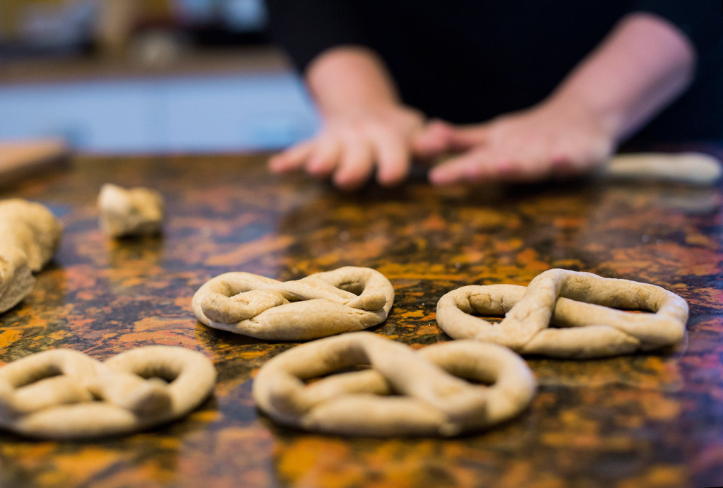 The pretzel dough is rolled out into thin strips.