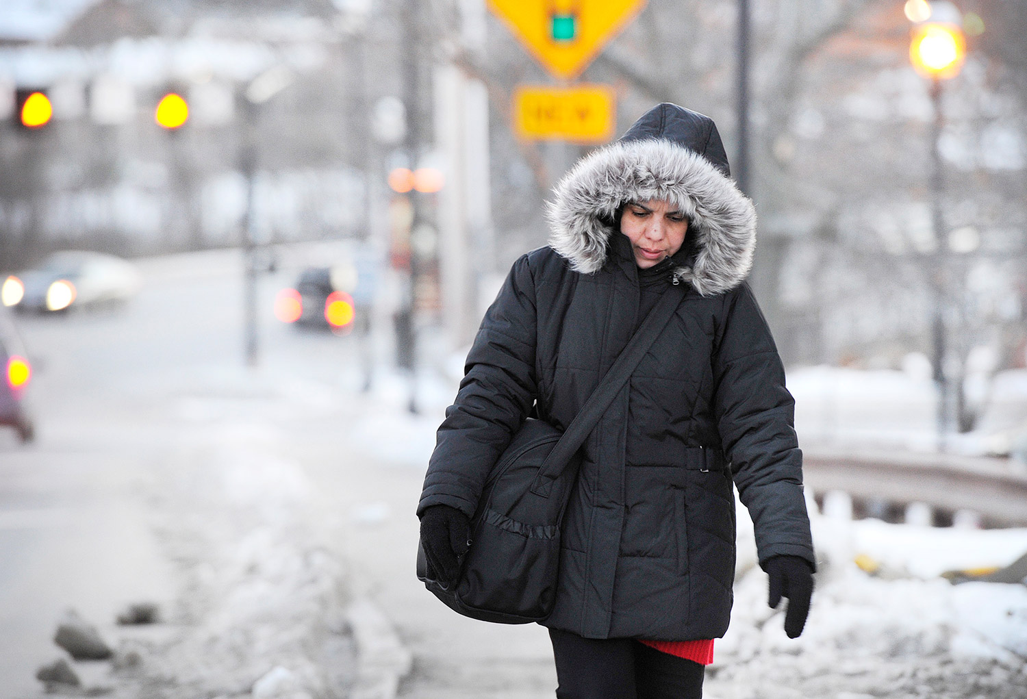 A woman bundled up for frigid weather makes her way up the sidewalk on Factory Island in Saco on Thursday. The temperature was expected to drop below zero overnight. Shawn Patrick Ouellette/Staff Photographer