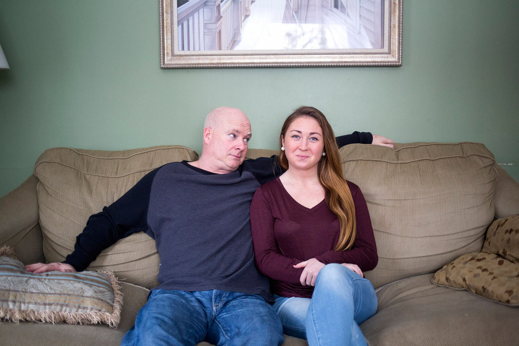 Dan Howard and his daughter, Shannon Howard, pose for a portrait in the living room of the family home in Cape Elizabeth. Shannon is spending almost a month at home during college winter break, and her father posted a humorous video of himself telling his Facebook friends about her return that ended up going viral.