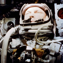 "Astronaut John Glenn pilots the ""Friendship 7"" Mercury spacecraft during his historic 1962 flight as the first American to orbit the Earth."