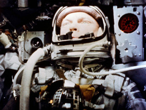 """Astronaut John Glenn pilots the """"Friendship 7"""" Mercury spacecraft during his historic 1962 flight as the first American to orbit the Earth."""