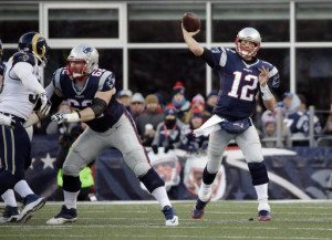 New England Patriots quarterback Tom Brady (12) passes against the Los Angeles Rams during the second half of a game on Sunday, Dec. 4, 2016, in Foxborough, Mass.
