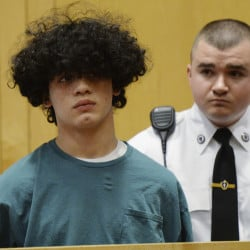Mathew Borges, 15, attends his arraignment in Lawrence District Court in Lawrence, Mass., on Monday.