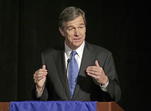 North Carolina Governor-elect Roy Cooper says lawmakers will repeal a contentious bill that has hindered his state's economy.  <em>Associated Press</em>