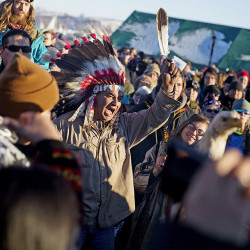 Protesters celebrate at the Oceti Sakowin camp after it was announced that the U.S. Army Corps of Engineers won't grant an easement for the Dakota Access oil pipeline in Cannon Ball, N.D., Sunday. Associated Press/David Goldman