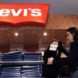 A store employee stocks a Levi's jeans display at a downtown Toronto department store.  Associated Press/CP Kevin Frayer