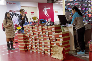 A man shops for shoes at a Qiaodan Sports retail shop in Beijing Thursday. Associated Press/Ng Han Guan