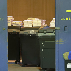 Ballots are stacked up behind a door as a statewide presidential election recount begins Thursday in Milwaukee – the first candidate-driven statewide recount of a presidential election in 16 years. Donald Trump won the state by less than a percentage point over Hillary Clinton after polls long predicted a Clinton victory.  Associated Press/Morry Gash