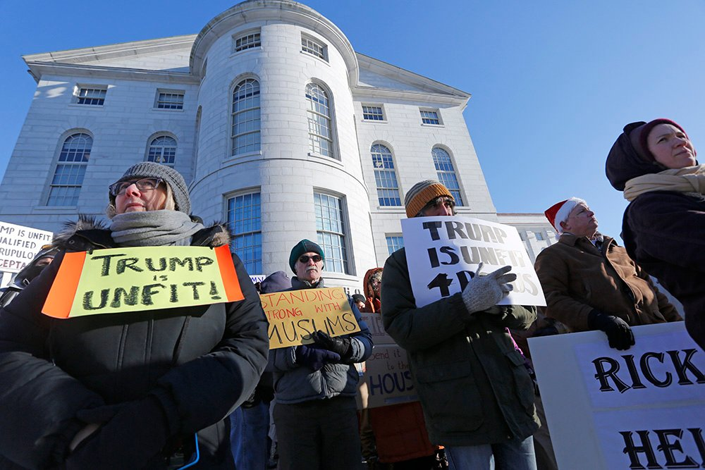 Anti-Trump protesters gather in the cold outside of the Maine State House in advance of Maine's Electoral College vote on Monday.
