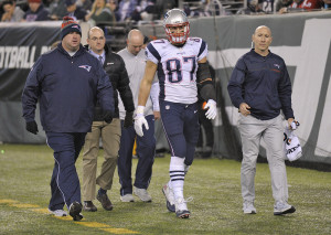 New England Patriots tight end Rob Gronkowski walks off the field after he was injured in the second quarter of Sunday's game against the New York Jets. Associated Press/Bill Kostroun