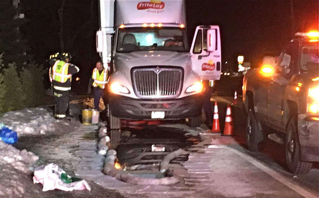 Emergency crews work at the scene Wednesday morning to mop up an diesel fuel spill on Route 26 in Oxford. <em>Photo courtesy of WCSH</em>