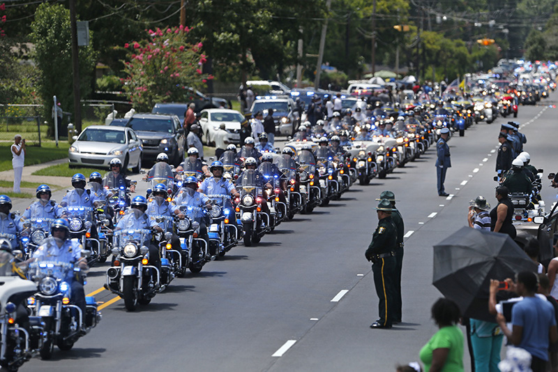 The funeral procession for slain Baton Rouge police Corporal Montrell Jackson leaves in Baton Rouge, La. in July.  Jackson was slain by a gunman who authorities said targeted law enforcement.