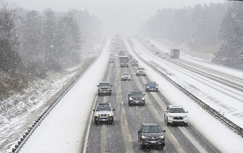 Vehicles make their way along the Maine Turnpike in Saco as snow falls Thursday. The speed limit has been reduced to 45 mph from the New Hampshire border to Augusta.