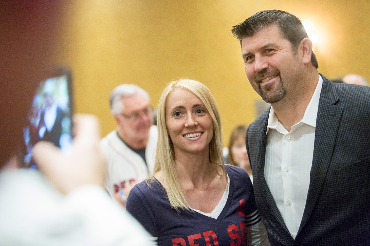 Jason Varitek, as popular as ever in Maine, poses for a photograph Friday with Angela Pease of Augusta at the Portland Sea Dogs' annual Hot Stove Dinner.