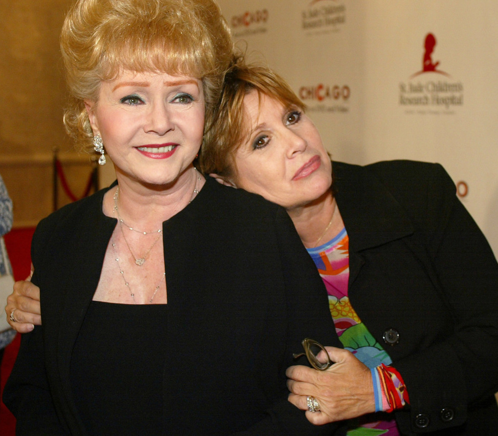 Debbie Reynolds and Carrie Fisher arrive at an event in 2003.
