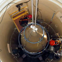 An Air Force missile maintenance team removes the upper section of an ICBM with a nuclear warhead in an undated photo. Donald Trump's national security adviser says that the president-elect supports missile defense system upgrades in order to maintain a position of strength.