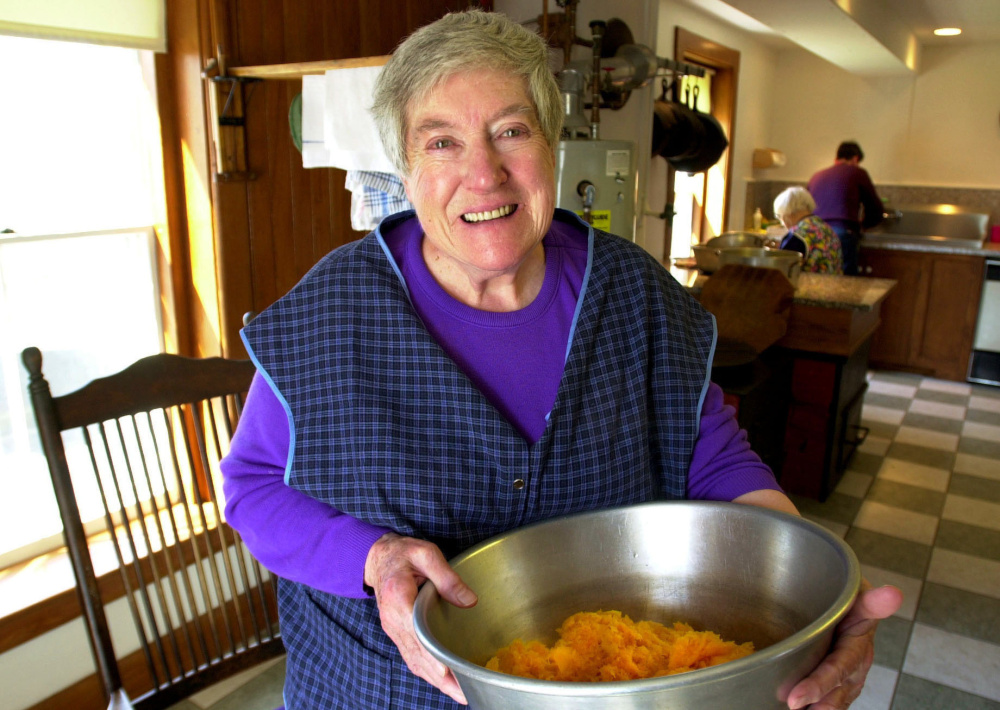 Sister Frances Carr, an elder at the Sabbathday Lake Shaker Village, preparing dinner in the community's kitchen in April of 2000. She died Monday at 89.