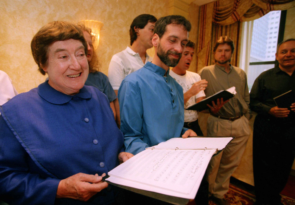 Sister Frances Carr, left, and Brother Arnold Hadd of the Shaker Village in Sabbathday Lake, Maine, sing with the Boston Camerata during a rehearsal at New York's Warwick Hotel, Sept. 13, 1995. Shakers and the Camerata have a recording
