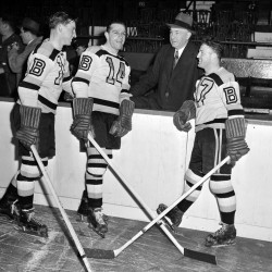 """In this October 1945 file photo, Boston Bruins manager """"Uncle Arthur"""" Ross is pictured with his players, from left, Milt Schmidt, Porky Dumart and Bobby Bauer, known as the team's """"Kraut Line"""", during hockey practice at Boston Garden in Boston. Schmidt, a hockey hall of famer, has died at the age of 98. Schmidt, the NHL MVP in 1951, was the league's oldest living former player."""