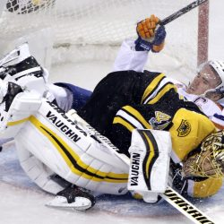 Oilers center Connor McDavid crashes into Bruins goalie Tuukka Rask in the first period Thursday night in Boston.