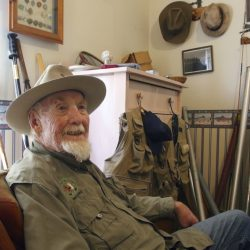 Bud Lilly sits in his house in Three Forks, Mont., surrounded by mementos of a fly-fishing life.