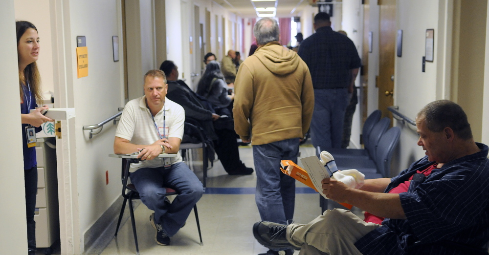 Veterans line up to receive medical care during the 17th Homeless Veterans Stand Down at the Togus VA in October 2014. New programs have made housing possible for vets in Maine.