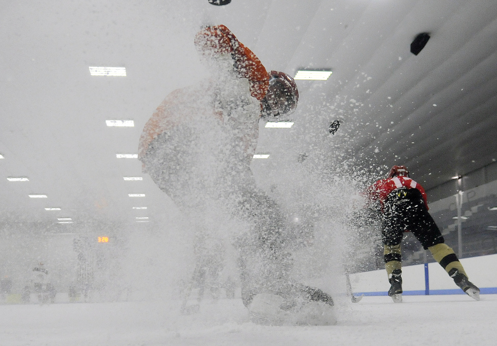 Cony's Tyler Dostie works through a drill during a Nov. 21 practice at the Camden National Bank Ice Vault. The Rams (4-2-0) are third in Class A North Heal points.