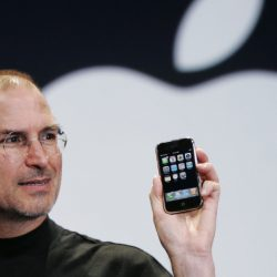 On Jan. 9, 2007, Apple CEO Steve Jobs holds the first version of the iPhone at the MacWorld Conference in San Francisco. He correctly called it 'a revolutionary product.'
