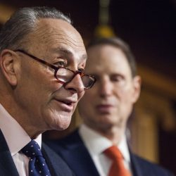 Senate Minority Leader Charles Schumer of New York, left, accompanied by Sen. Ron Wyden, D-Ore., speaks during a news conference on Capitol Hill in Washington. Democrats planned hours of Senate speeches Monday to condemn the Republican push to obliterate President Barack Obama's health care overhaul.
