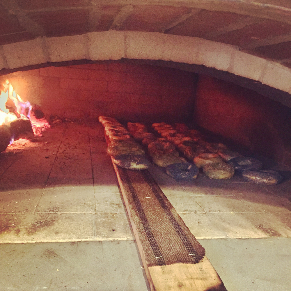 Bagels in the wood-fired oven at The Purple House in North Yarmouth.
