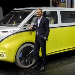 Herbert Diess, chairman of Volkswagen, poses with the I.D. Buzz all-electric concept van at the North American International Auto Show on Monday in Detroit. Booming business in China helped VW increase its sales to 10.31 million vehicles last year.