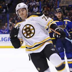 Boston Bruins' Frank Vatrano celebrates after scoring a goal as St. Louis Blues' Alexander Steen skates nearby during the first period Tuesday in St. Louis.