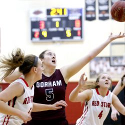 Mackenzie Holmes of Gorham reaches for a rebound between Jordyn Cowan, left, and Brooke Malone of Scarborough during the first quarter of Gorham's 58-26 victory Wednesday night. Gorham reached 9-0 – the only undefeated team in Class AA South.