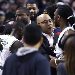 Jae Crowder of the Boston Celtics, right, is held back by assistant coach Micah Shrewsberry from continuing a confrontaion with John Wall of the Washington Wizards following the Celtics' victory at home Wednesday night.