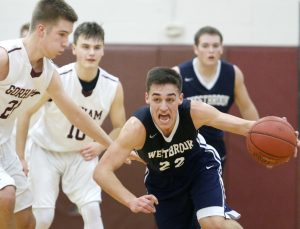 Zac Manoogian of Westbrook keeps the ball away from Kyle King of Gorham while heading up the court following a steal in the second quarter.