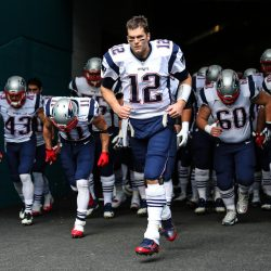 Tom Brady leads the Patriots onto the field to face the Miami Dolphins on Jan. 1. Don't tell him that the Patriots will roll over the Texans in Saturday night's playoff game.