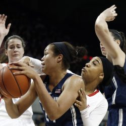 Connecticut forward Napheesa Collier, center, battles SMU guard Devri Owens, second from right, during the first half of an NCAA college basketball game, Saturday, Jan. 14, 2017, in Dallas. (Associated Press/Brandon Wade)