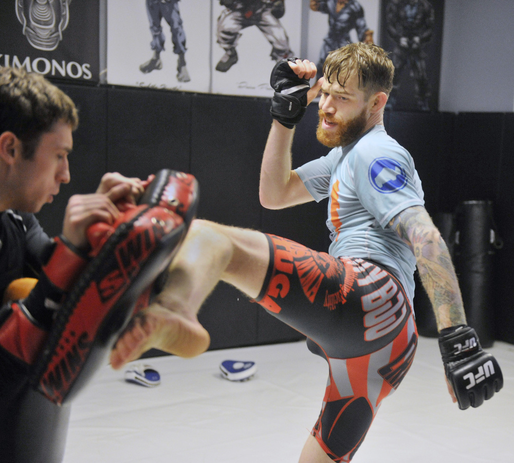 Powell spars with Muay Thai teacher Tim Hagan.