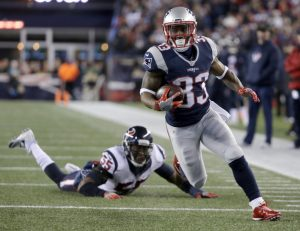 Patriots running back Dion Lewis leaves Houston's Benardrick McKinney in his wake on the way to the first of three touchdowns Saturday night in the AFC playoffs at Gillette Stadium. The Patriots won, 34-16.