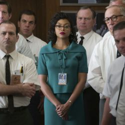 "Katherine Johnson, played by Taraji P. Henson, listens with her white male colleagues in a scene from ""Hidden Figures."""