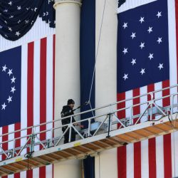 A worker prepares for Friday's presidential inauguration of Donald Trump at the U.S. Capitol during a rehearsal Sunday.