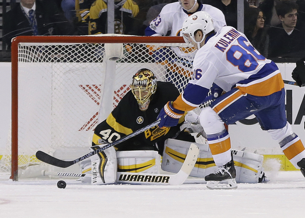 Nikolay Kulemin of the Islanders scores one of his two goals against Bruins goalie Tuukka Rask during a 4-0 victory Monday afternoon at TD Garden.