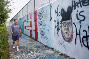 Karl Miller of Portland walks past the image of Gov. Paul LePage on the graffiti wall on Portland's Eastern Promenade last year. The Portland Water District invites public comment Jan. 25 on whether graffiti artists should continue to use the wall.