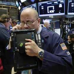 Trader Jeffrey Vazquez works on the floor of the New York Stock Exchange last week. Stock prices are likely to be more volatile in 2017 than in recent years, a change that should benefit financial professionals.
