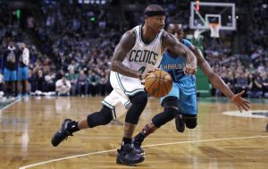 Celtics guard Isaiah Thomas drives to the basket past Charlotte guard Kemba Walker in the first quarter of Monday night's game in Boston. Once again, Thomas was the Celtics' go-to guy in the fourth quarter.
